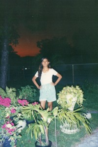 Fashion victim with over-sized striped green shorts. I was around 16 years old.
